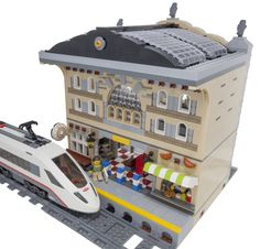 """https://flic.kr/p/rJAVDs   Train Station Diorama Rear   Would you like to see this model sold as a genuine Lego set? Please support my design on <a href=""""https://ideas.lego.com/projects/101885"""" rel=""""nofollow"""">Lego Ideas</a>. Thanks for your help! I'm considering this model finished, with all of the last details put in place. It's been a lot of fun designing my first modular building! It fits right into my modular street, and gives me a way to fit a train into the diorama."""