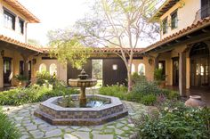 Mediterranean home with a central courtyard complete with a tiled fountain, about as classic as it gets.
