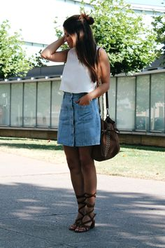 #outfit wearing #denim skirt, white top, suede bag and lace up sandals. More on: http://www.littleblackcoconut.com/2016/07/denim-skirt.html#more