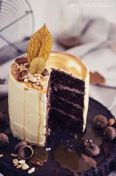 chocolate peanut butter cake with caramel and white chocolate frosting