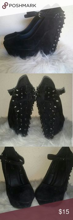 """Black Velvet Wedge MaryJanes Amazing faux velvet wedges with spikes and black rhinestones that will get you noticed! Maryjane styleeee with a strap and buckle and a rounded toe. The heel including the platform is about 5"""" high. Ordered from Shoe Dazzle for a holiday party and they were too small...but i still wore them, duh. If you're an actual 7.5 these will be too small that's why I have them listed as a 7....a 6.5 would probably fit fine too!  WARNING: The spikes DO hurt so be careful…"""