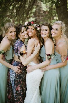 Maid of Honour Musings: Pick out a different dress for your maid of honour to make her stand out. This pick ties in with the bride's floral crown perfectly.