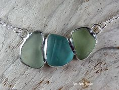 Simple elegant style. 3 pieces of sea glass join together in one pendant. Aqua, soft green and frosted white combined to make this easy breezy nautical style necklace. Happy beach-combing!    The triple sea glass cluster measures just over 1 3/8 inches long. The overall length is 18 with a loop at 17 inches allowing the necklace to be shortened if needed. All on a sterling silver chain.    The one of a kind necklace is handcrafted using sea glass found on Pacific North West beaches. Each…