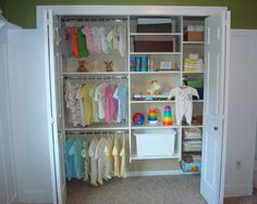child or baby closet organization. love the space for toys, multiple size appropriate clothing bars.