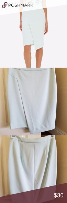 """LIKE NEW Mint Asymmetrical Pencil Skirt- Sz 4 Mint condition, mint color from The Limited in sz 4. Light mint color, pretty & subtle.  Split front, origami hem (but w/ the two pieces sewn together so as to keep things modest).  Side zipper & satin lining. Great for the office, nights out, or special events.  Worn once for a wedding.  Makes a pretty outfit w/ the Ann Taylor mint flutter top that's also listed!  Waist: 14.5"""", hips 18.5"""", length: 22.5"""".  Labeled sz 2 but best for sz 4-6. The…"""