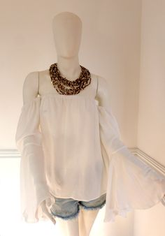 #bardot #offshoulder #offshouldertop #colombiandesigner #colombia #fashiontrends #white #necklace White Necklace, Off Shoulder Tops, Summer Trends, Bardot, Ruffle Blouse, Boho, Fashion Trends, Design, Women