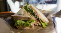 Club sandwich on brown paper