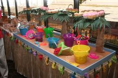 """Our candy/ cookie/ cupcake bar at our  casual """"At Home reception"""" after our wedding in Mexico. The """"sand"""" is made from cinnamon and sugar. All the guests got bags to bring treats home with them. My wonderful husband built this for us. It smelled amazing too!"""