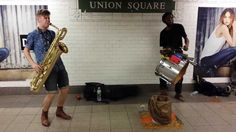 TOO MANY ZOOZ Baritone Saxophone and Drummer Duo Street Performance in N...