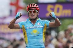 Kazakhstan's Alexandr Vinokourov celebrates as he crosses the finish line to win the Men's Road Cycling race at the 2012 Summer Olympics, Saturday, July 28, 2012, in London. (AP Photo/Christophe Ena)