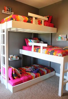 We have been dreaming about custom triple bunk beds since we found out we  were having girl number three over three years ago! They finally became a  reality and we built these amazing beds for our girls a few months ago. We  love how they turned out and the kids absolutely love them! Disclaimer: if  you hate making beds, you will really hate making these ;)  Shelves and bedding are from IKEA. Large wooden initials are from Hobby  Lobby.  BUY THE PLANS BELOW!   Triple Bunk Bed Plans 5.00…
