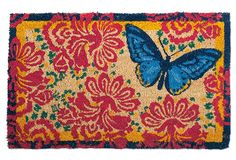 beautiful butterfly print doormat made of natural coir, a material from coconut husks. what a lovely welcome at home on the front porch or doorstep. pink and blue prints, from the global artistry collection