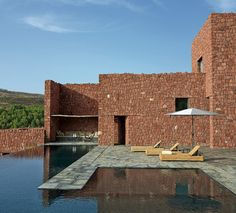 Villa E by Studio KOPerched high on a hill like a modern day...