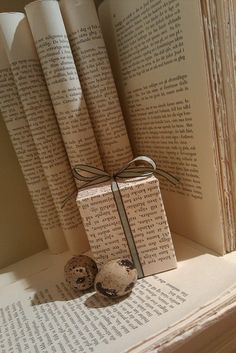 Book wrapping paper! Talk about cheap! lol. And you could also stamp red stars on this for christmas!
