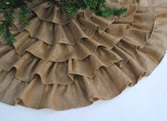 I so HAVE to make at least one of these ruffled Christmas tree skirts this Christmas, hopefully more with many types of fabrics. {Ruffled Burlap Tree Skirt 60 Inch by PaulaAndErika on Etsy, $150.00}