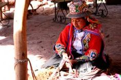 A local woman weaves in the market.