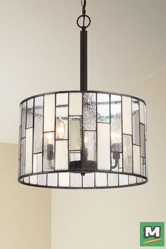 Patriot Lighting® Ronan Pendant with Antique Bronze Finish and Tiffany-Style Glass.