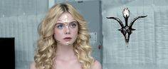"""""""The Neon Demon"""" Reveals The True Face of the Occult Elite - The Vigilant Citizen - Symbols Rule the World - At the photoshoot, Jesse has a shiny thing glued to her face. Its shape is reminiscent to the head of Baphomet, complete with horns and the torch of illumination. While this might be a coincidence, the occult context of the movie would say otherwise."""