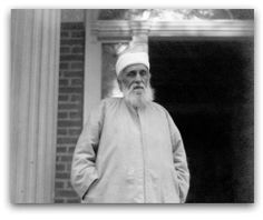 'Abdu'l-Bahá standing in front of the home built for Him at 1818 R Street, N.W. by Mrs. Agnes Parsons