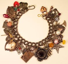 Charm bracelet w/vintage beads, buttons, filigree, locket...