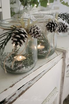 centerpieces - mason jars with winter decor. pinecones, holly, pine, glitter…