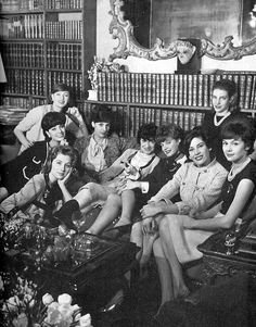 Chanel surrounded by her favorite models, left to right: Ghislaine Arsac, Marie-Hélène Arnaud, Suzy Parker, Odile de Cröy, Coco Chanel, Paule Rizzo, Mimi d'Arcangues, Gisèle Rosenthal and Paule de Mérindol, photo by Willy Rizzo, 1959