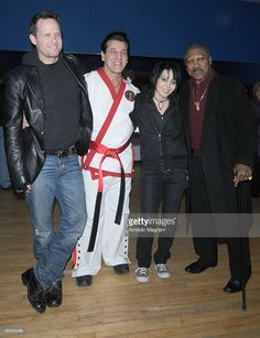 Boxer Joe Frazier (R), boxer, actor Chuck Zito (2nd-L), actor Dean Winters (L) and musician Joan Jett (2nd-R) appear together at Street Survival School of martial arts at the Omni on January 30, 2010 in Pelham, New York.