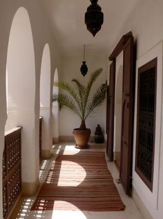 portico - wood gates each side, moroccan pendant light, potted palms...this is how I want my master suite balconies at both my Kauai and AZ homes!!!!!!