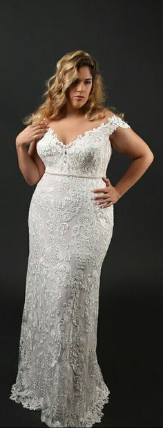 Stunning mermaid lace plus size wedding gown with off shoulder sleeves. Adel. Studio Levana