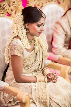 Traditional Indian bride wearing bridal saree and jewellery.  For matrimony Service visit our matrimony website goo.gl/HNT1Mz