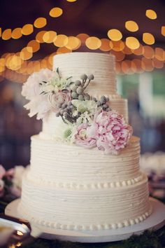 Simple tiered cake in cream, pink and grey with peonies, scabiosa & brunia berries