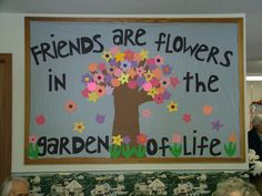 """""""Friends Are Flowers in the Garden of Life"""" is such a sweet title for a spring bulletin board display.  I would have my students write about a special friend inside a flower template and add it to this bulletin board display theme."""