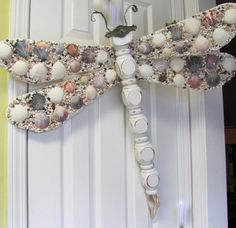 Yes, please! I know I can make these and get rid of some of the shells I have laying around the house. THAT alone would make McHottie happy!  Table Leg Dragonfly Wall Art shell mosaic by LucyDesignsonline, $75.00