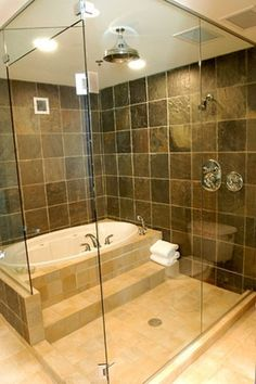Tub in shower - kids can splash and swim as much as they want! Brilliant idea for adults too. Take a bubble bath and shower off at the end. Just step out of the tub and shower off.---- genius.