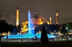 Famous Hagia Sophia provides backdrop for multicolored fountain in Istanbul's Sultanahmet Park