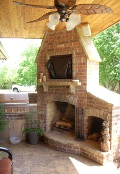 Outdoor Fireplace and Grill..now that's an awesome corner fireplace, spot for firewood and tv, with speakers!