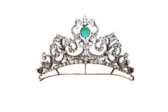 A diamond and emerald tiara, with diamond scrolls either side of a central motif holding an oval emerald