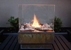 DIY: firepit.  Cheap glass frames, metal planter, cheap grill grates, rocks, marine silicone and gel fuel.  Only takes an hour to make!!!!