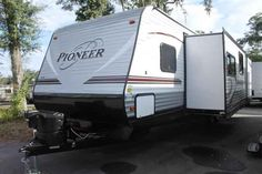2016 New Heartland Pioneer DS310 Travel Trailer in Florida FL.Recreational Vehicle, rv, 2016 Heartland PioneerDS310, Bike Rack, Black tank flush, Enclosed Underbelly, Night shades, Pioneer Value Package, Power Awning w/ LED Light Strip, POWER STAB JACKS, Power Tongue Jack, RVIA Seal, Spare Tire and Carrier, Winterization of Unit,