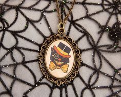 I just bought this : )    Vintage Retro Halloween Black Cat Necklace by Goraline on Etsy
