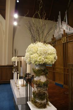 hydrangea balls with curly willow and birch twigs with vases wrapped in birch bark and moss accents  http://www.fiorire.ca