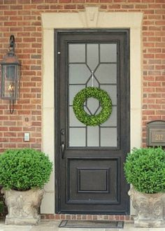 """Love this charcoal front door with the frosted glass on a brick house; For a similar look, try Pittsburgh Paint's """"Phantom Mist 530-7""""."""