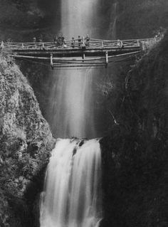 Years before Multnomah Falls was part of a public park, a homesteader built a log bridge over the cascading water. (Oregon Historical Society)