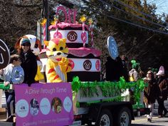"Bideawee marched into the 46th Annual Westhampton St. Patrick's Day Parade in March!  Bideawee's float celebrated the parade theme, ""A Drive Through Time."" The Parade theme was a perfect fit as Bideawee is celebrating its 110th Anniversary. The Bideawee float depicts a large Birthday cake surrounded by pictures and logos from Bideawee's history in the community."