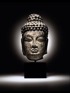 Rare limestone head of Buddha. Tang Dynasty, early 8th century, possibly Longmen caves.