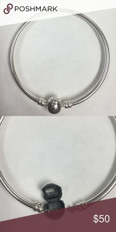 19 cm/7.5in Pandora bangle Solid traditional Pandora bangle. Great for a stand alone bracelet or you can put charms on it. I don't really wear it as much so barely any scuffs or dents on the bracelet. Pandora Jewelry Bracelets
