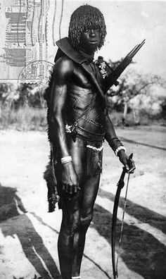 Africa | Sudanese warrior. Posted in 1953 || Scanned vintage postcard