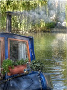 Old smokey narrowboat, somewhere on the canal's in England. [ HDR ]