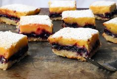 shortbread crust with layers of homemade lemon and blueberry custards