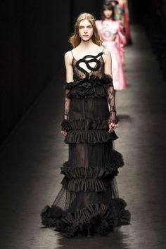 Like something out of a Tim Burton fairy tale—these lace-loving ladies prefer the darker side of pretty. Balmain, Valentino and McQueen are proponents. (Gucci)